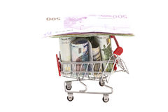 Shopping cart full of euro banknotes Stock Image