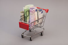 Shopping cart full of euro banknotes Royalty Free Stock Photography