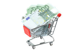 Shopping cart full of Euro banknotes Royalty Free Stock Image