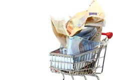 Shopping cart full of euro banknotes on white background Stock Photos