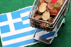 Shopping cart full of euro money over Flag of Greece Stock Image