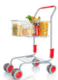 Shopping cart full with food products Royalty Free Stock Images