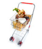 Shopping cart full with food products Royalty Free Stock Photos