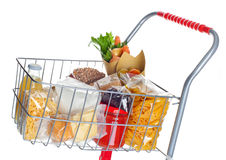 Shopping cart full with food products Stock Photos