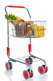 Shopping cart full with food products Stock Images