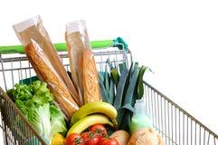 Shopping cart full of food white stock photos