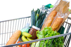 Shopping cart full of food  white side view Royalty Free Stock Photo