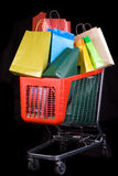 Shopping cart full of gifts royalty free stock photos
