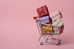 Shopping cart full of gifts Royalty Free Stock Image