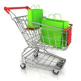 Shopping cart full of green shopping paper bags Stock Photo