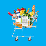 Shopping cart full of groceries and receipt. Shopping cart full of groceries products and receipt. Grocery store. Supermarket. Fresh organic food and drinks Royalty Free Stock Images