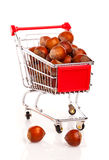 Shopping cart full of hazelnut Stock Photos