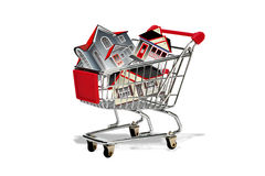 Shopping cart full of houses Royalty Free Stock Photo