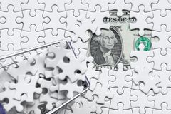Shopping cart full of jigsaw puzzle on money dollar background,. Business solution concept ,key for success Stock Image