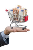 Shopping cart full of money Royalty Free Stock Photography