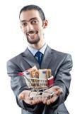Shopping cart full of money Stock Photo