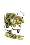 Shopping Cart full of money. Shopping cart made of metal used for carrying groceries full of money in the form of many large bills Stock Images