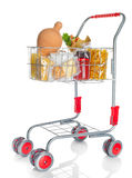 Shopping cart full with money box and food products Stock Photo
