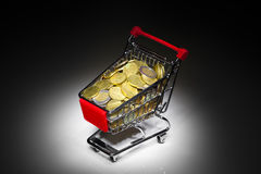 Shopping cart full of money Stock Photo