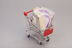 Shopping cart full of money (dollar, euro) Stock Photography