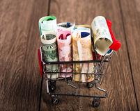 Shopping cart full of money (dollar, euro ) Royalty Free Stock Images