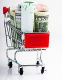 Shopping cart full of money (dollar, euro ) Stock Photos