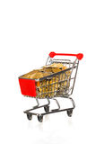 Shopping cart full of money Royalty Free Stock Photos