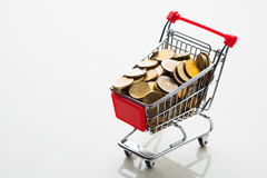 Shopping cart full of money Royalty Free Stock Photo