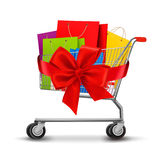 Shopping Cart Full Of Shopping Bags And A Gift Bow Royalty Free Stock Photos