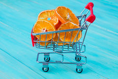 Shopping cart full of orange slices Stock Image