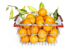 Shopping cart full of oranges Stock Photo