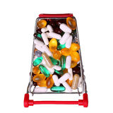 Shopping cart full with pills and capsules isolated Royalty Free Stock Images