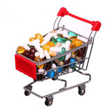 Shopping cart full with pills and capsules isolated Royalty Free Stock Photos
