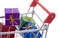 Shopping cart full of presents Stock Photo