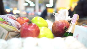Shopping cart full of products quickly driven in the supermarket stock footage
