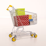 Shopping cart full of purchases in packages Stock Image