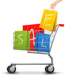 Shopping cart full of shopping bags with a sale Stock Photography