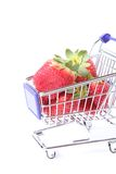 Shopping cart full of strawberries Royalty Free Stock Images