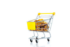 A shopping cart full with various groceries Royalty Free Stock Photos