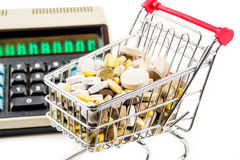Shopping cart full of vitamin supplements Royalty Free Stock Photography