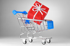 Shopping cart with gift box Royalty Free Stock Photo