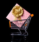 Shopping Cart with gift box. Isolated in black, view from side Stock Image