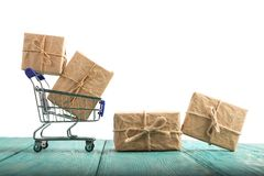 Shopping cart with gift box isolated on a white background royalty free stock photos