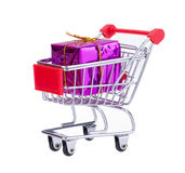Shopping Cart With Gift Box. Shopping Cart With A Purple Colored Gift Box Isolated On White Background Royalty Free Stock Photos