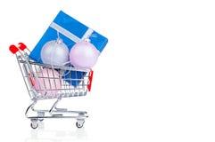 Shopping cart with gift box and Xmas balls Royalty Free Stock Photo