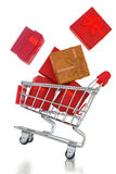 Shopping cart with gift boxes Stock Photos