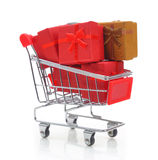 Shopping cart with gift boxes Royalty Free Stock Images