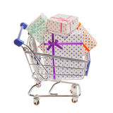 Shopping cart with gift boxes Stock Images