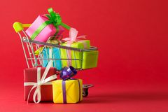 Shopping cart with gift. Shopping cart filled with variety color of gift boxes Stock Photography