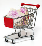 Shopping cart and gift Stock Photography